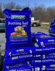 blue bag of potting soil