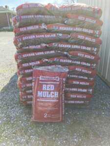 bag of shredded dyed red mulch